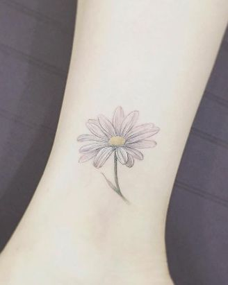 Daisy ankle tattoo by Tattooist Flower
