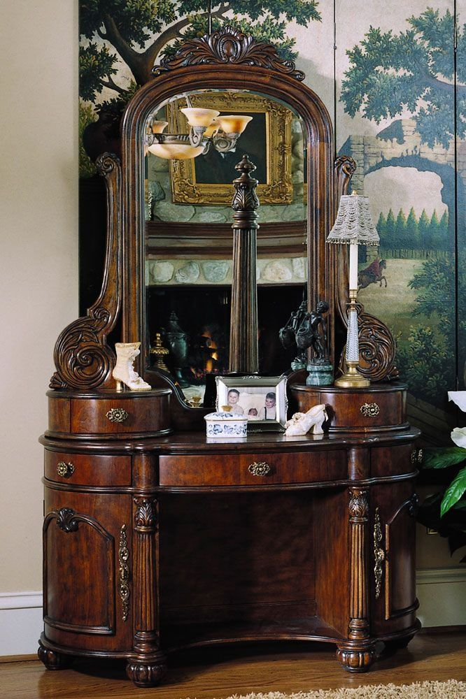 Antique Vanity- love the depth of the wood and the amount of storage drawers