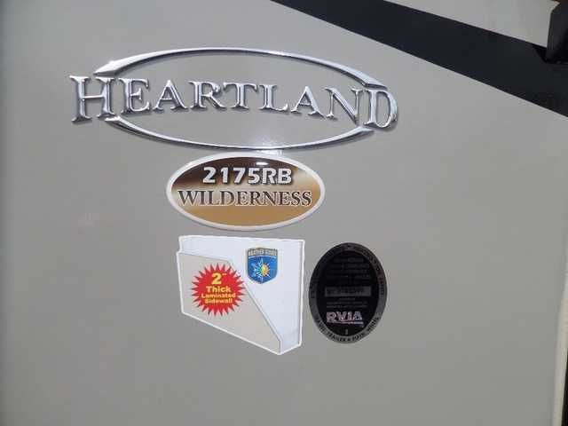 """2016 New Heartland WILDERNESS 2175RB Travel Trailer in Ohio OH.Recreational Vehicle, rv, Dry Weight 4,648 lbs Hitch Weight 490 lbs Carrying Capacity Width 8' 0"""" Height 11' 4"""" Length 26' 2"""" Sq. Ft. Sleeping Capacity 3-4 People Axles (2) 3,500 lbs Tires ST205/75R14-D Shocks --- Fresh Tank 36 gal Gray Tank 35 gal Black Tank 35 gal Water Heater 6 gal Gas/Electric/DSI Furnace 35,000 btu A/C 13,500 btu LP Capacity (2) 20 lbs Refrigerator 6 cu ft 110/LP 110 V Electric 30 AMP Converter 55 AMP / 12 V…"""