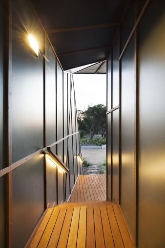 A sheltered entranceway connects to the driveway and uses several different lights