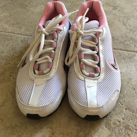 Pink Nike Shocks Pink Nike Shocks. Basically brand new. I bet I wore these less than 5 times..... They were given to me as a gift and I just don't really wear tennis shoes. These are a 3.5 youth but they must fit like a women's 5.5 since I could wear them..... Nike Shoes Athletic Shoes