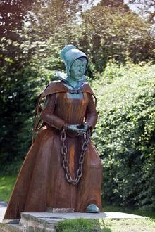 Statue of Alice Nutter in Roughlee, Pendle, Lancashire, England. Alice was tried, convicted, and executed as one of the Pendle Witches in 1612.
