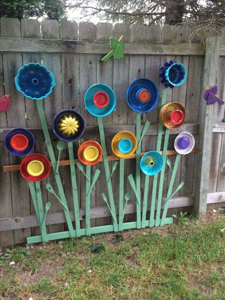 Garden art made with jello molds plates serving utensils Home decorating ideas using junk