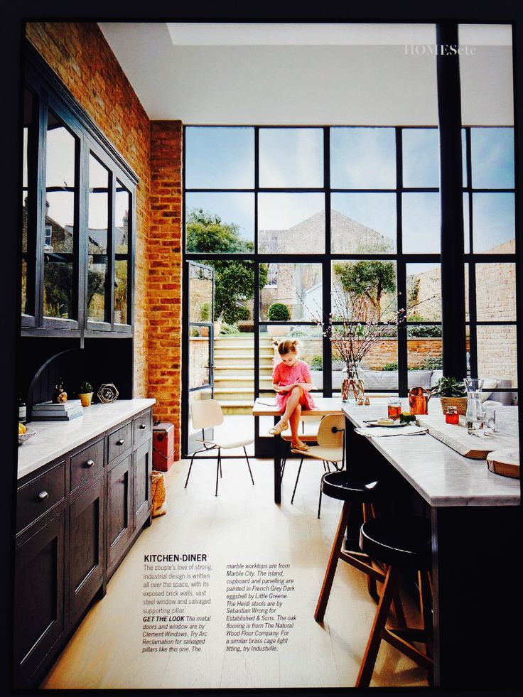 Dining room inspiration: especially like the exposed brick and 'crittall' windows/doors