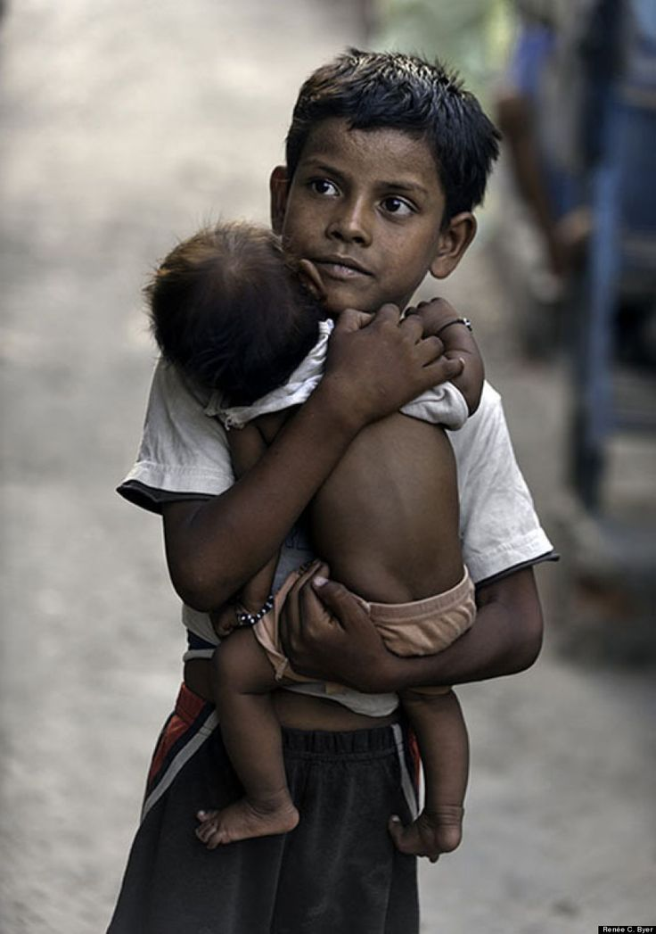 Also true among the poor is that fact that children everywhere take care of other children. Here Vishal Singh, 6, cares for a baby girl while her mother is away in the Kusum Pahari slum in south Delhi, India.