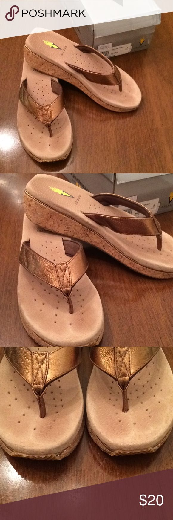 Volatile Cream Puff flip flops size 9 bronze Cute cork wedge flip flops from Volatile in a great bronze color. Size 9. Excellent condition! Neutral color that can be worn with so much. Volatile Shoes Sandals