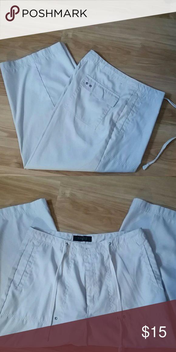 Kaki Capris. Soft brushed material. Drawstring waist and button.flap pockets. Lee Pants Capris