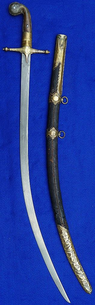 "Ottoman kilij, 18th-19th century, damascus / wootz steel blade, brass mounts with traces of gilding, spiral stitched leather on wood scabbard, horn grips with light restoration. Length is 37"", blade is 31""."