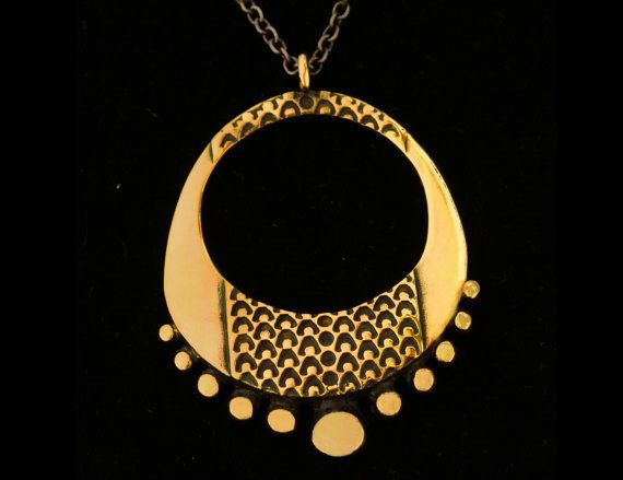 Bronze pendant designed by Finnish jewelry designer Pentti Sarpaneva in the 60's. I've this pendant and I want to add more of his work to my collection!