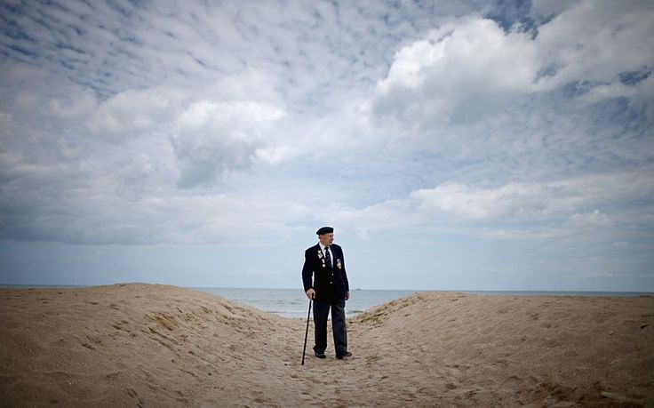 D-Day veteran George French, aged 89, of The Kings Royal Rifles and from Swindon, poses on sword Beach after the Royal Artillery Commemoration Parade Picture: CHRISTOPHER FURLONG/GETTY
