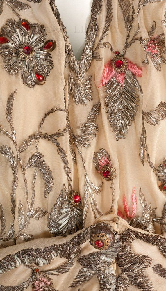 Detail of the Madeleine Vionnet evening gown.  In 1918 Vionnet hired Marie-Louise Favot. As a dressmaker and trained artist, Favot  designed all of Vionnet's embroidery motifs. Though the motifs were designed in-house, the actual work was contracted out to Michonet, a Parisian embroidery firm founded in 1858. Michonet was later  bought by Albert Lesage.