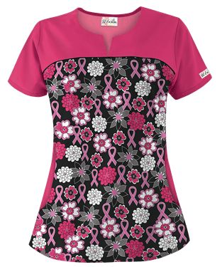 """For a unique look, try the """"UA Pink Power Black"""" print top featuring a rounded neckline and a V-notched detailed yoke. Two deep half moon pockets to hold all of your accessories. There are also back darts and side slits for extra comfort! """"UA Pink Power Black"""" print fabric is 55/45 Cotton/Poly. The approximate length for size medium is 28.25"""".  #uniformadvantage #uascrubs #uagivesback #pinkribbon #breastcancerawareness"""