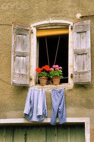 Pajamas Hanging in Window in Saint Andre-de-Valborgne, France by Owen Franken