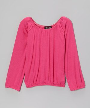 With its soft, sleek drape, this top delivers world-class style. Fashion-forward girls are sure to appreciate the elastic that adorns the neckline, hem and sleeves, providing the perfect slip-on fit.