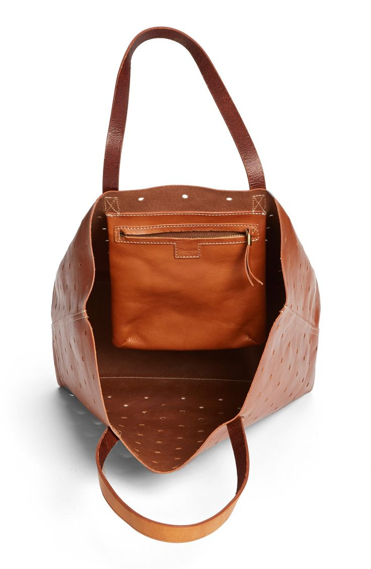 Free shipping and returns on Madewell 'The Hole Punch' Perforated Leather Transport Tote at Nordstrom.com. Hole-punch perforations define a rugged everyday tote fashioned from sleek brown leather. The stylish design includes an interior zip pocket in addition to the spacious main compartment.