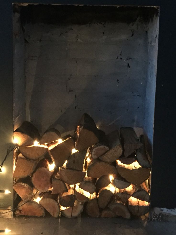Logs with fairy lights through it