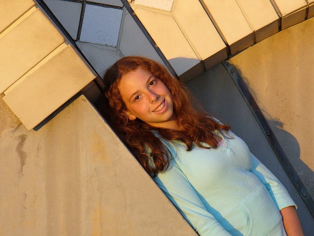 My daughter, Claire, leaning against the side of the Sydney Opera House, via Flickr.
