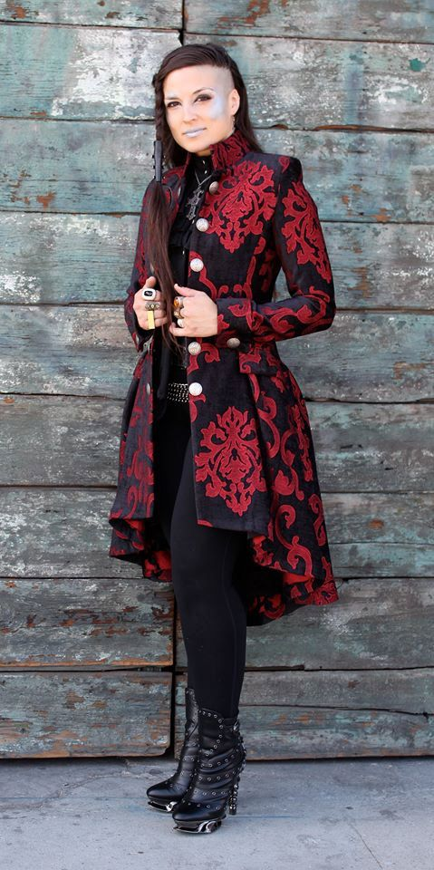 A luxurious modern romantic frock coat made in rich velvet brocade fabric with an intricate tapestry pattern. The coat is fitted through the