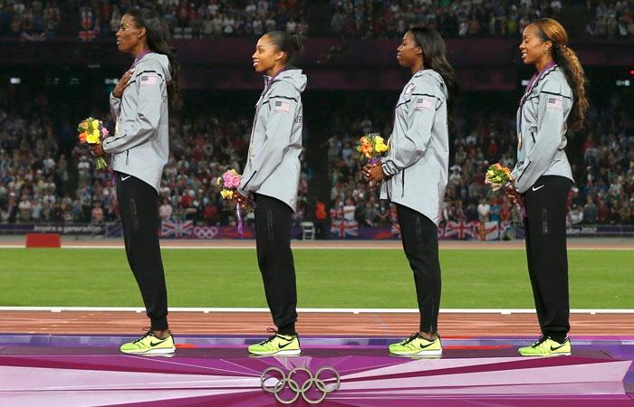 DeeDee Trotter, Allyson Felix, Francena McCorory and Sanya Richards-Ross listen to the anthem