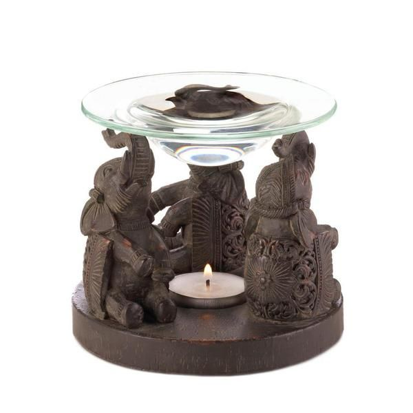 Three talented elephants are on parade to fill your home with delightful aroma. This unique oil warmer features a sculptural base that holds a tealight candle,