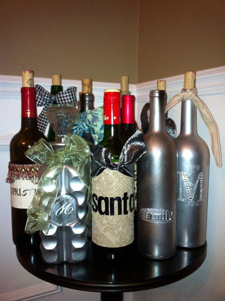Decorate empty wine bottles for the holidays.