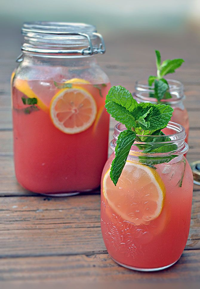 boozy watermelon mint lemonade | 2½ pounds watermelon flesh, seeds removed, cut into chunks  ¼ cucumber, cut into chunks  1 cup fresh lemon juice, plus an additional lemon, sliced, for garnish  ¼ cup packed mint leaves, plus more mint, for garnish  2½ cups white rum, vodka, or water  ¼ cup agave syrup or simple syrup
