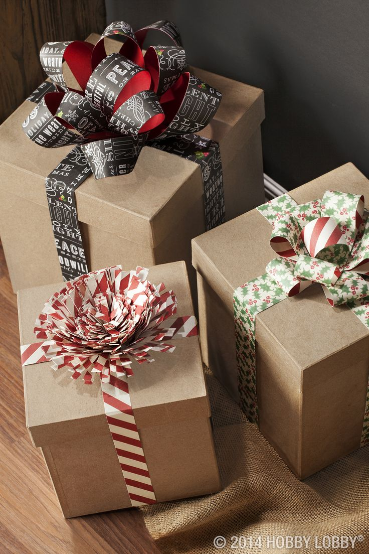 #papercraft #giftwrap. Holiday hustle and bustle cleaned out your gift wrap stash? Try paper bows on paper maché boxes.