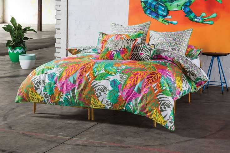 Eyecatching and designed to capture the attention, the Akela featuresabrilliant bright, tropicalprint with a collage of palm leafs and other flora.