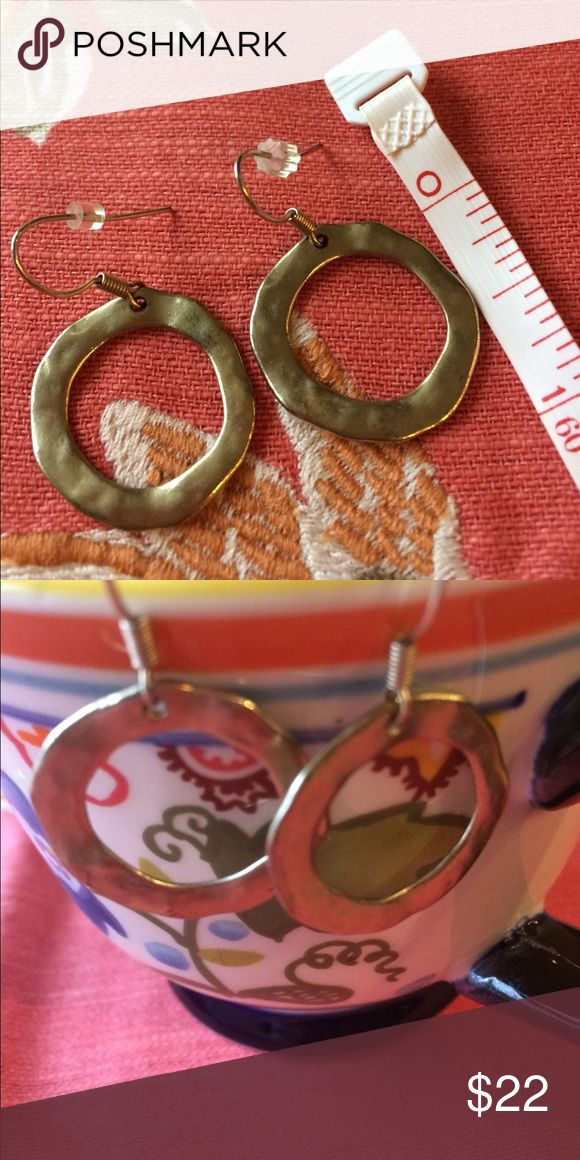 Gold tone hoops! Gold tone hoops! A stylish change from your everyday hoops! Will become an absolute go-to! These are hand-made, purchased at a small shop in White Bear Lake, Mn! Beautiful hammered finish and patina to these. Light as a feather when wearing! Back keepers included. Offers and bundles welcome! See other listings! I ship super fast too! Jewelry Earrings