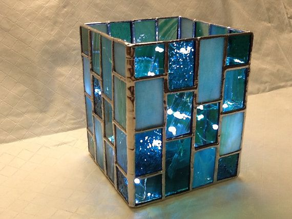 This is a beautiful turquose candle holder by HamptonsWorks, $40.00