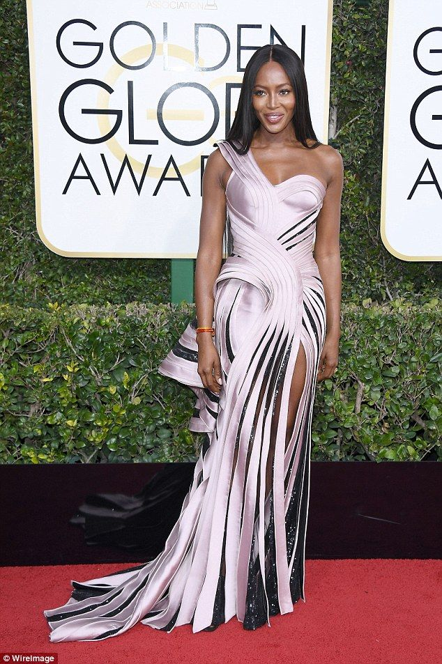 Give us a swirl! Naomi Campbell showcases her flawless style in a spiraling Versace gown as she arrives at the 2017 Golden Globes