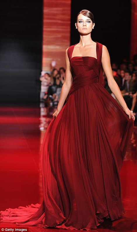 Ladies in red: Saab loves a rich crimson and used it to make a number of gowns, including this elegant sequinned frock