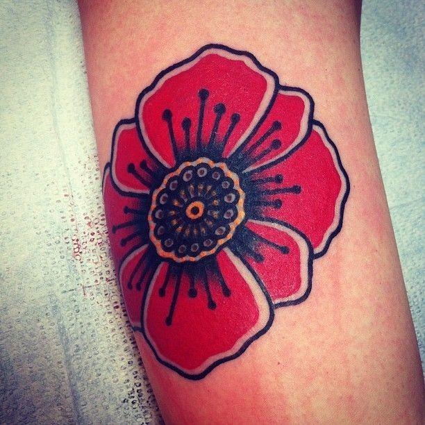 Old school poppy flower tattoo on arm