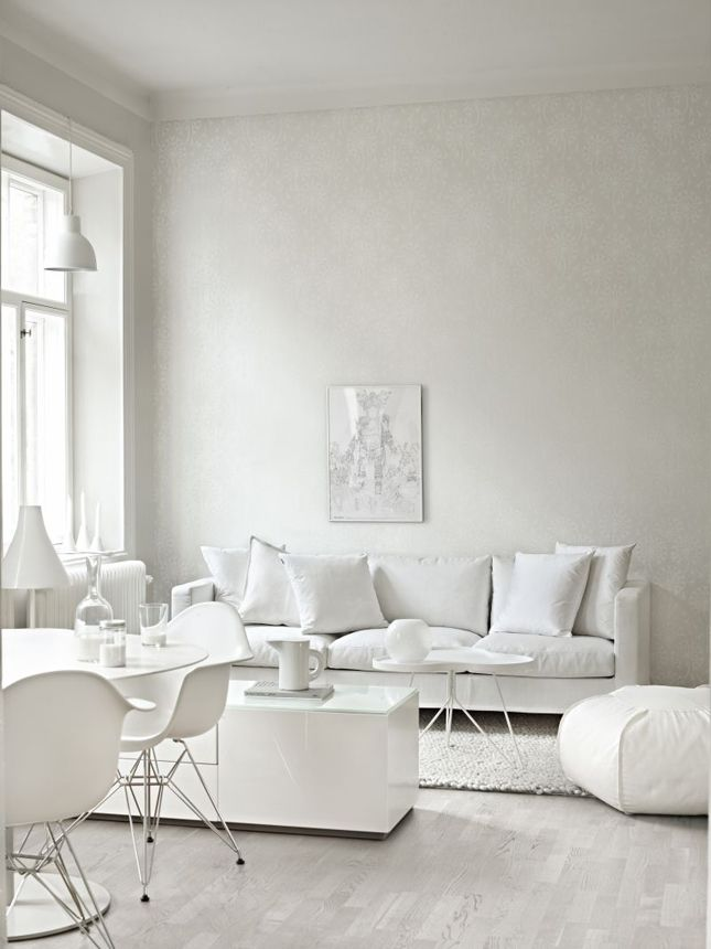 This all-white living room looks comfy as can be.: