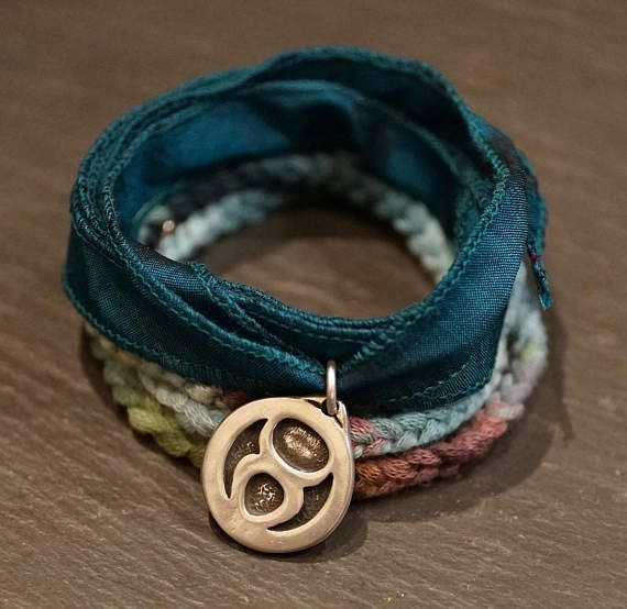 ZODIAC TAURUS, Warrior Wrap, bracelet and necklace, hand dyed silk, hand dyed hand woven cotton, pewter Taurus symbol, stainless steel, pure silver