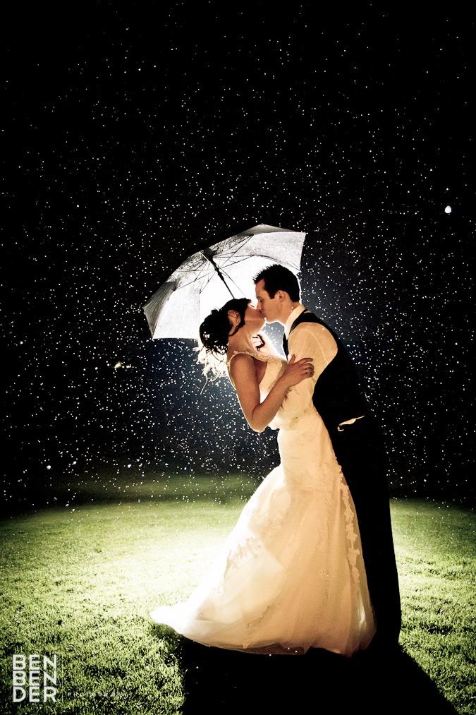 Romantic wedding portrait in the rain