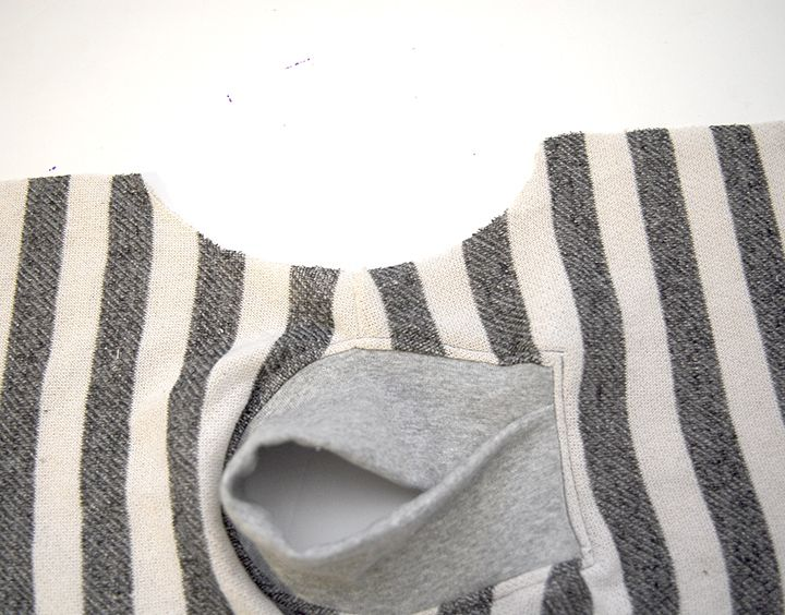 A free sweatshirt pattern for babies. Features a shawl collar for a clean and modern design. Free printable PDF file in Size 6-12m