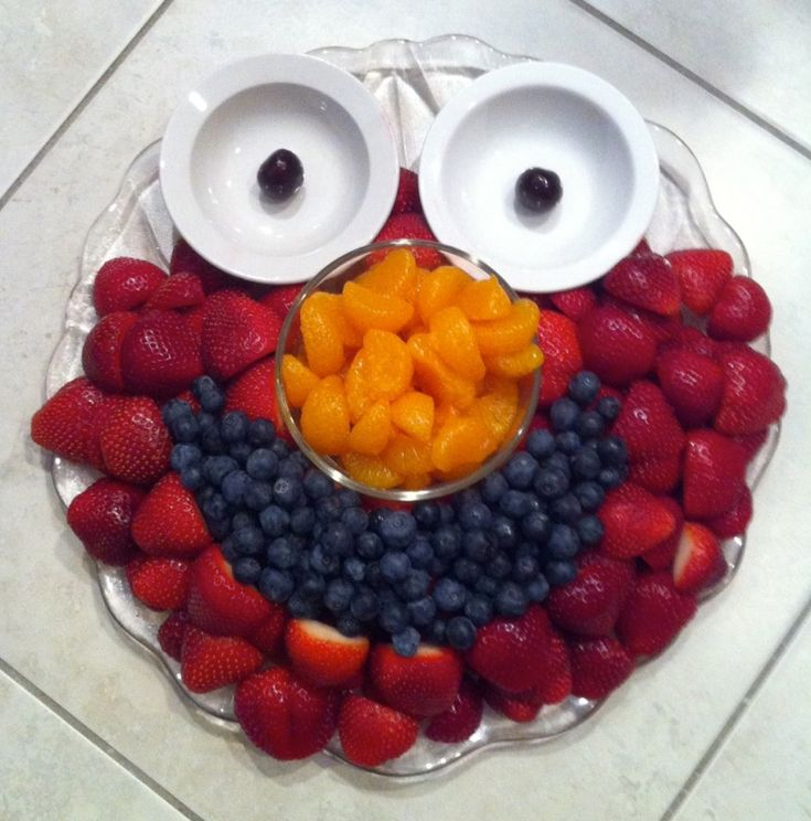Elmo fruit tray.  I'd put yogurt or white fruit dip in the little bowls for the eyes. Cute idea for a kids party- or fruit tray for the kids at a party.....could do oscar with vegtables for us instead of strawberries red raspberries