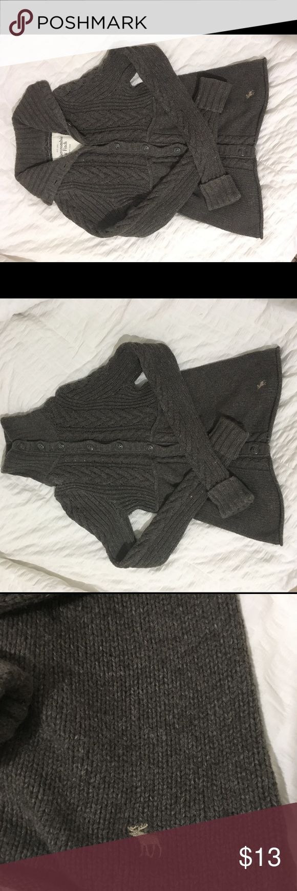 Abercrombie & Fitch knit button up sweater Super cute knit sweater, perfect for the cool weather months.  Gently worn inspected and no flaws seen.  Fabric tag see pic Measurements taken with garment laying flat : Sleeves 33 Length 23 1/2 Pit to pit 14 Abercrombie & Fitch Sweaters Cardigans