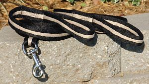 Mini Soft Driving Lines  Black and Tan 2 tone soft cotton driving lines are designed specifically for the minis. 10 foot lines with swivel snap. Handle at end and additional handle at 8 foot. $24.00 pair