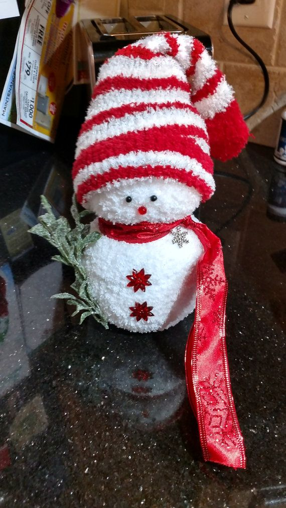 Festive sock snowman for your home, office, or where ever you choose for an easy Holiday decoration!  Made with rice, high quality socks, and accessories. Adornments are glued onto the body.