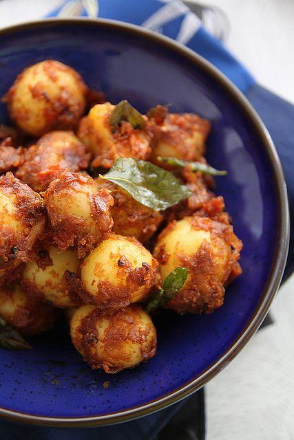 Spicy Bombay Potatoes: need red onion,ginger paste, garlic paste, coriander powder, chili powder, turmeric, cumin powder, 1 small tomato, garam masala, mustard seeds, a sprig of curry leaves, salt & oil.
