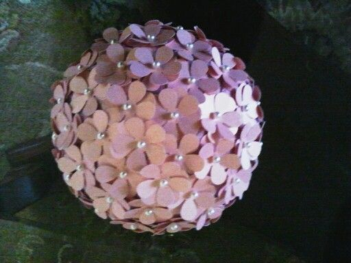Pomander ball - I used styrofoam balls and covered them with tissue paper. I used pink pearl scrapbook paper to make flower cutouts & pearl straight pins. The pearlized paper gave the flowers a sheen.  I placed on candle holders.  They can also be hung with ribbon or tulle.