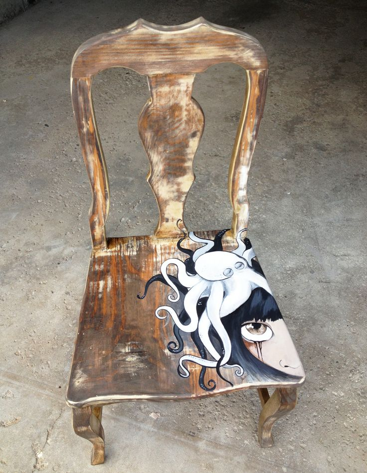 'Inked', painted onto a distressed wooden chair.