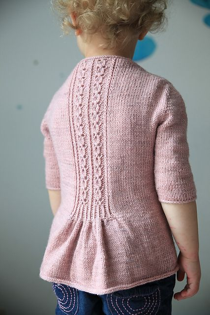 Knitted cardigan for kids - Ravelry: Fleur Bleue pattern by Christelle Nihoul. Love the detail on the back!