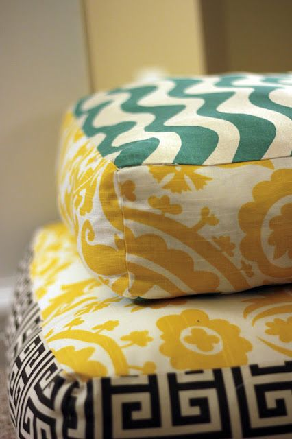 Make your own giant floor pillows. I might add a zipper to one side so that they could be more like slip covers that can be washed. Great and simple to make!
