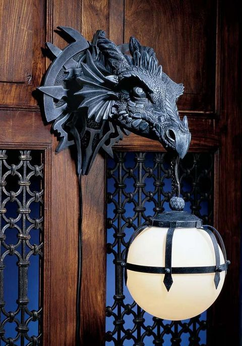 """Dragon sconce to light your way, because the night is dark and full of terrors.   32 Brilliant Home Decor Items Inspired By """"Game Of Thrones"""""""