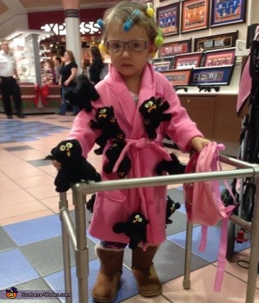 Christina: This is my 2 year old daughter. I bought a bulk of scaredy cats and attached them to a robe. My husband made her walker out of PVC pipe and...