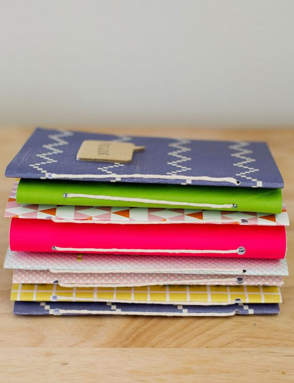 Make you're own notebook using a paper bag, pretty wrapping paper or scrapbook paper.