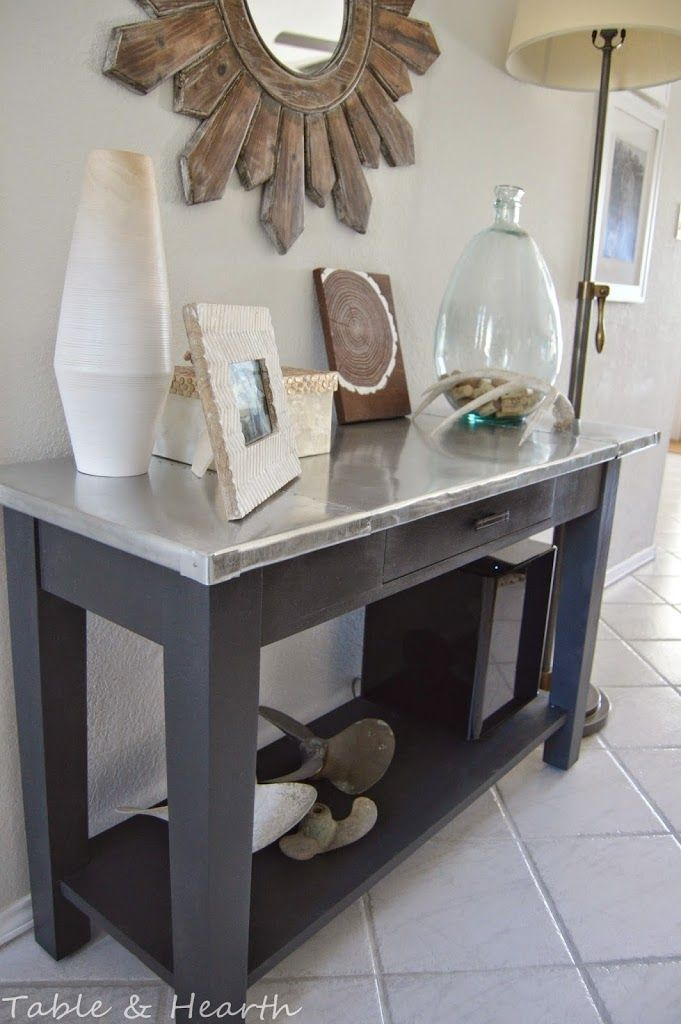 Updating an old, cheap console table by adding a riveted metal table top and refinishing with chalk paint.